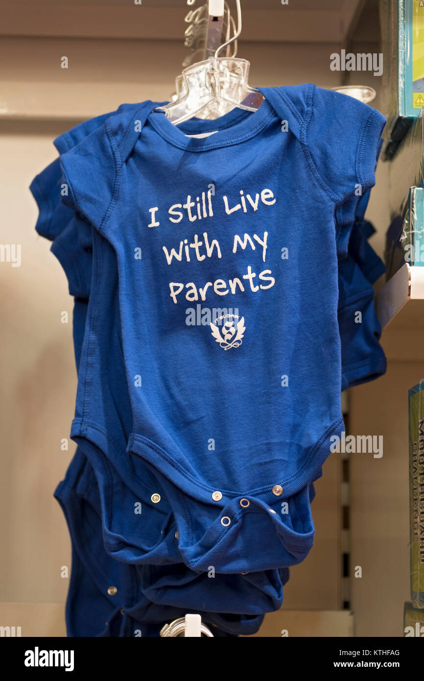 "A onesie for sale with the sarcastic lettering saying ""I still live with my parents."" At the It'sugar store on Broadway Stock Photo"