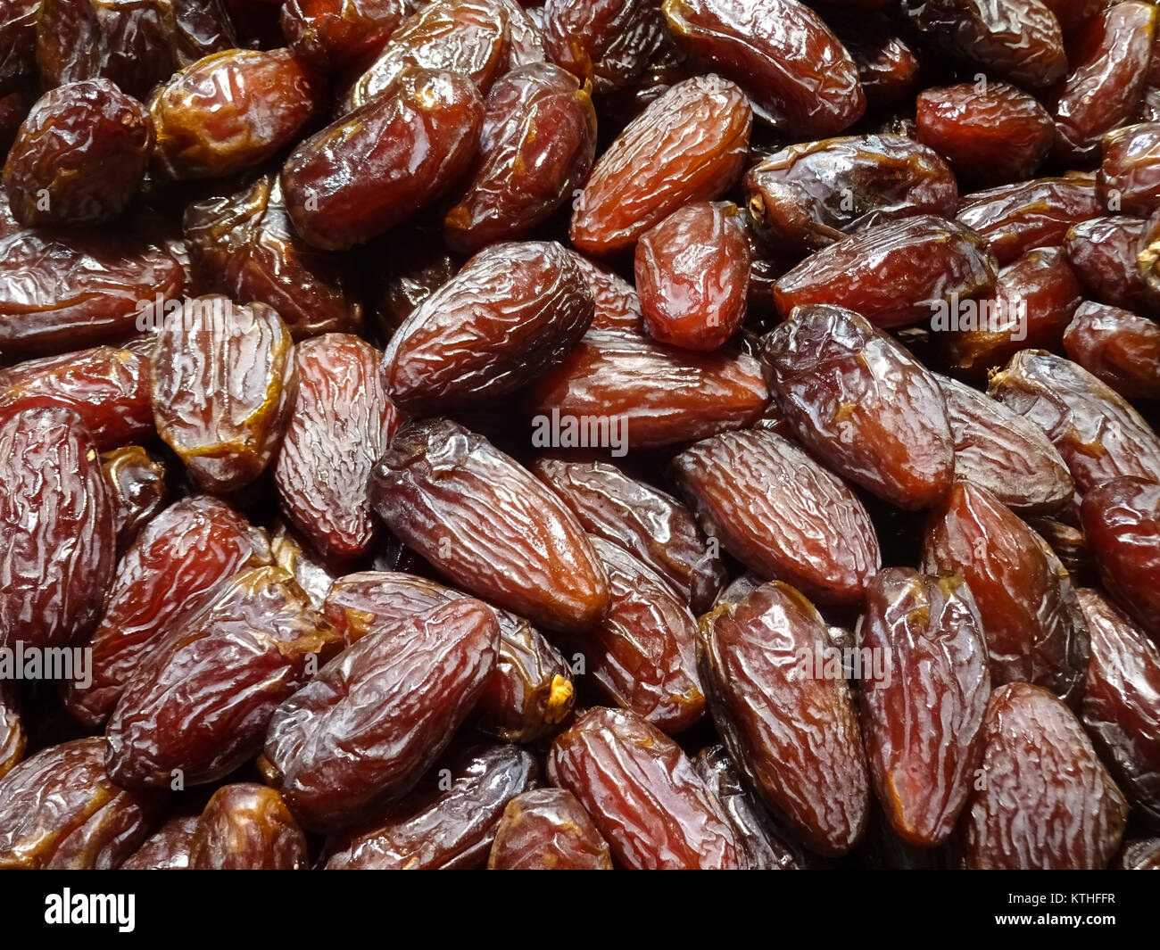 pile of dates , dried date fruits closeup - Stock Image