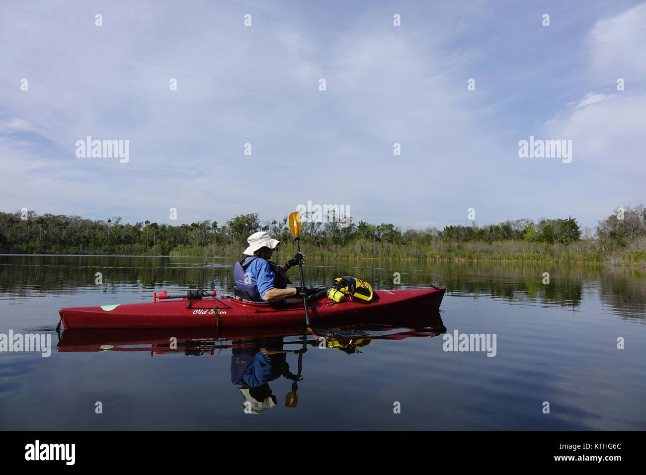 woman paddling kayak in Florida lake Stock Photo
