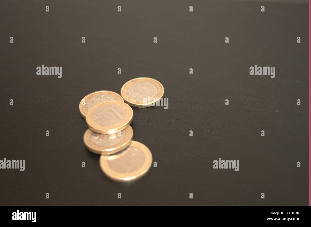 some euro coins and pennies on a dark background giving people the idea of money saving in bad economical situations.take Stock Photo