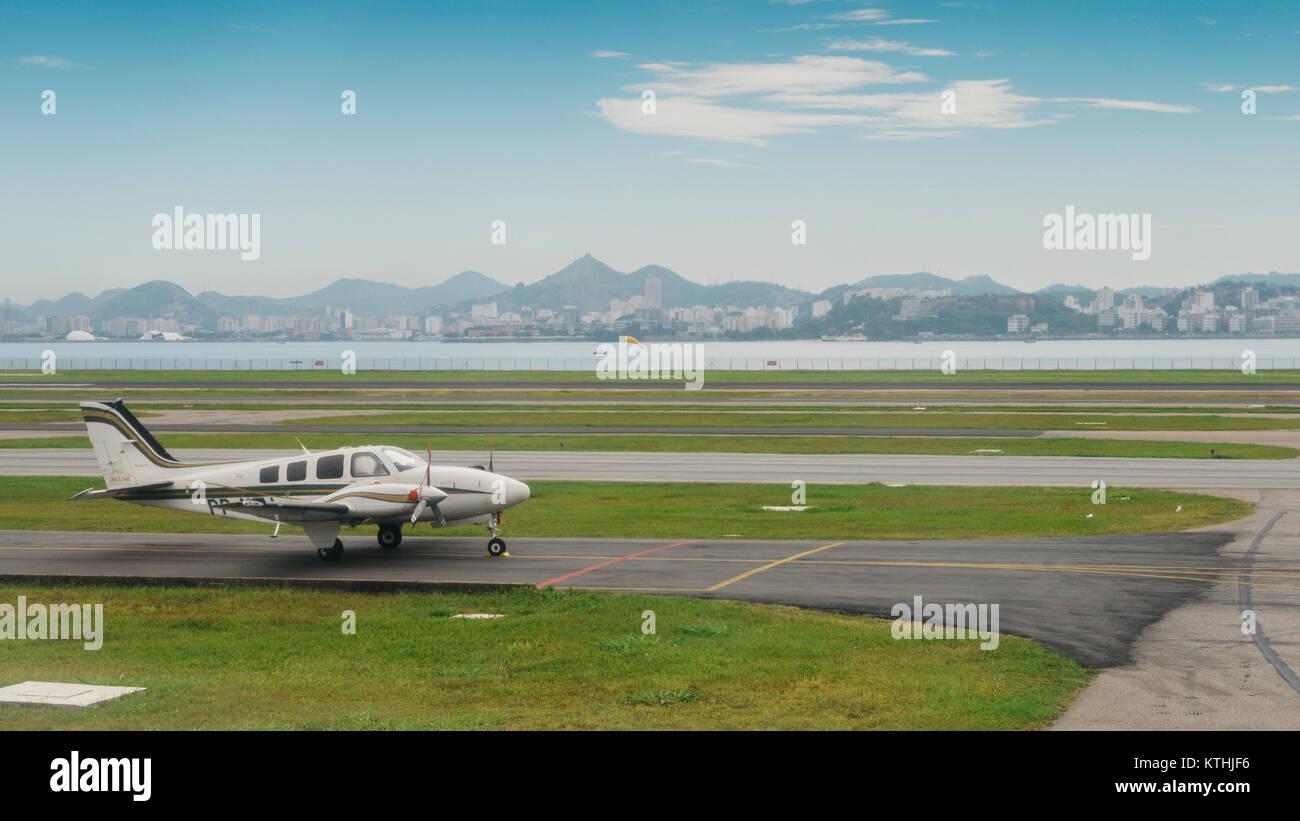 Beechcraft Baron B55 taxiing on the runway in Rio de Janeiro, Brazil - Stock Image