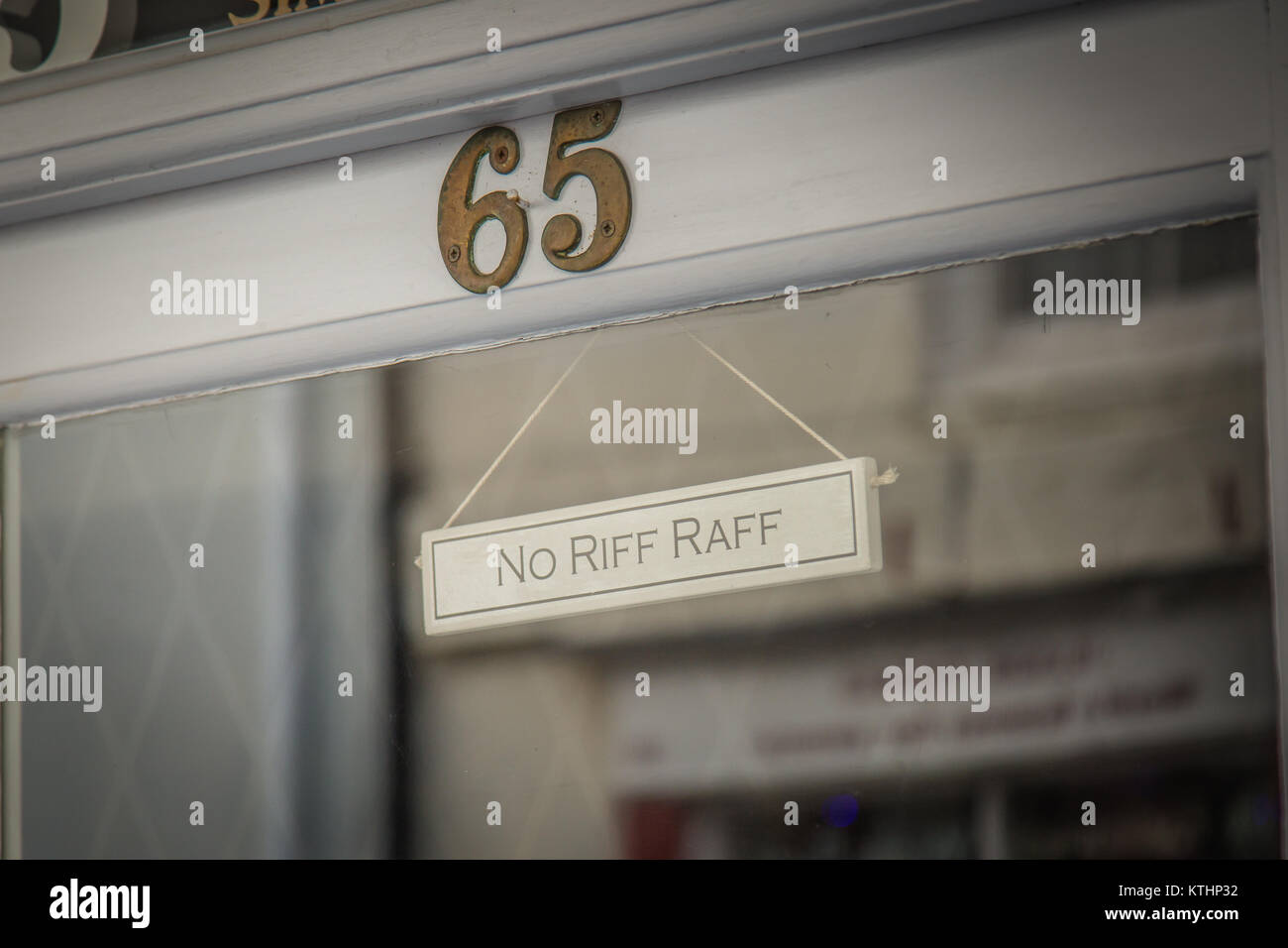 An unusual sign in a shop doorway,requesting 'No Riff-Raff'....in other words no one should enter who is - Stock Image