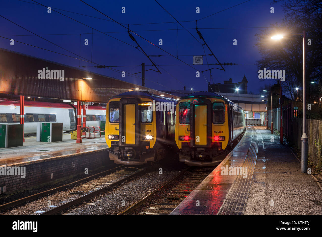 2 Arriva Northern rail class 156 sprinter trains at Lancaster station - Stock Image