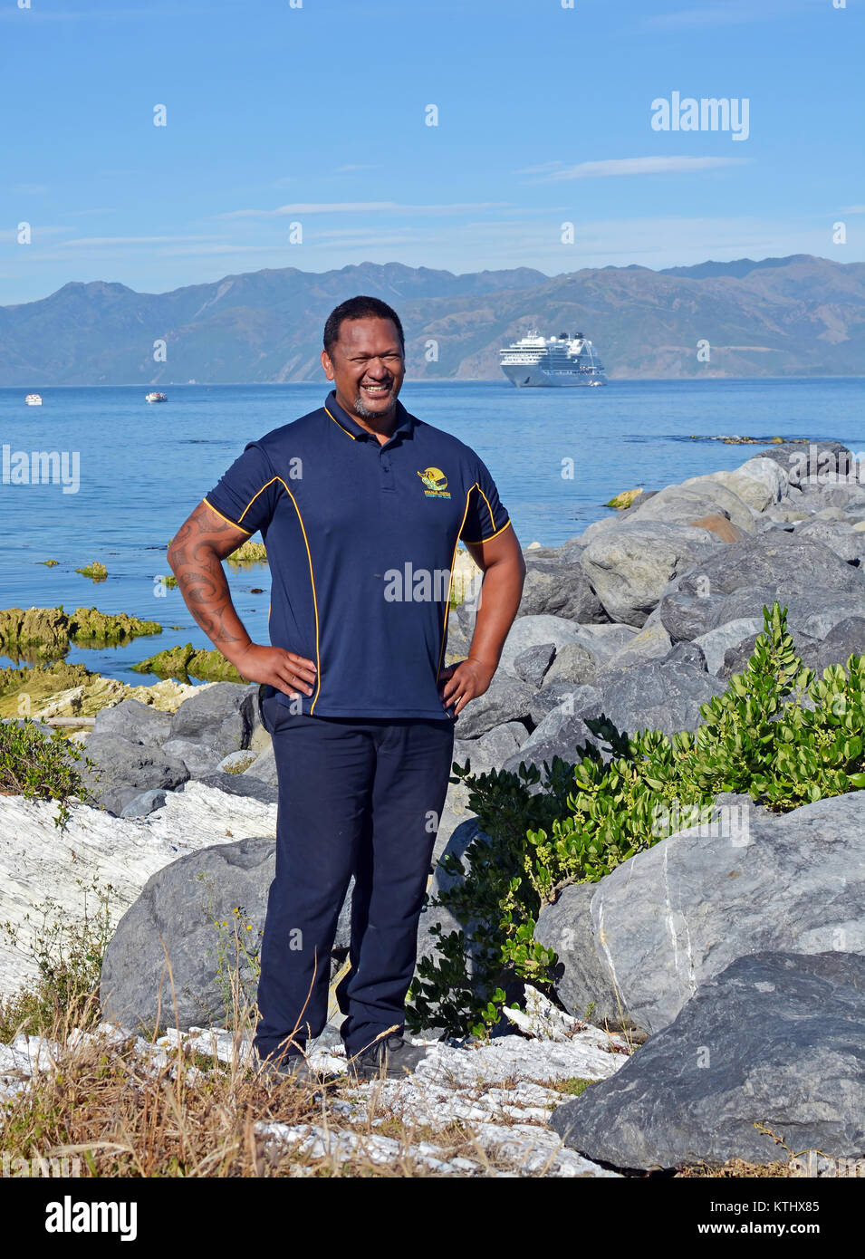 Kaikoura, New Zealand - December 15, 2017: Smiling Whale Watch Kaikoura Staff Member at South Bay Harbour with Cruise - Stock Image
