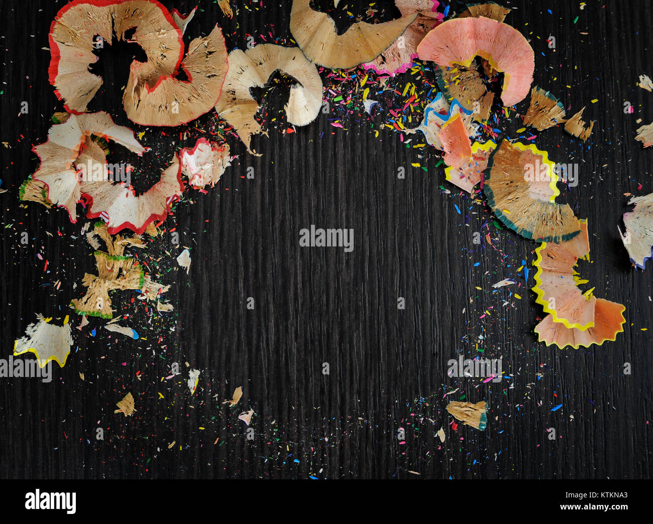 Bright colored abstraction on a dark background. Chips of crayons. Stock Photo