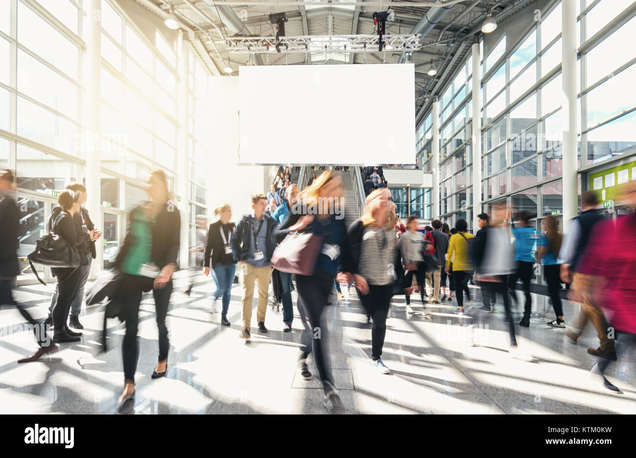 blurred business people at a trade fair - Stock Image