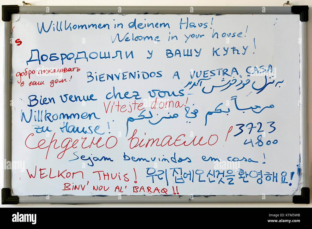 Yazd, Iran - April 22, 2017: A marker board from a youth hostel, containing a guest greeting, written by hand, on - Stock Image