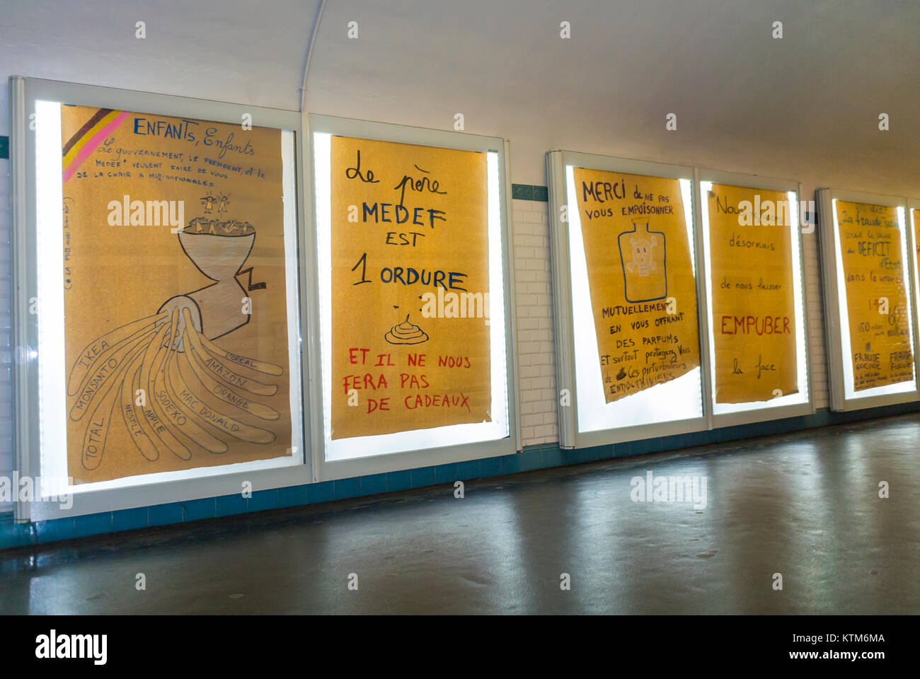 Paris, France, Anti French Advertising Protest, Metro Subway Posters , in Hallway of Invalides Station - Stock Image