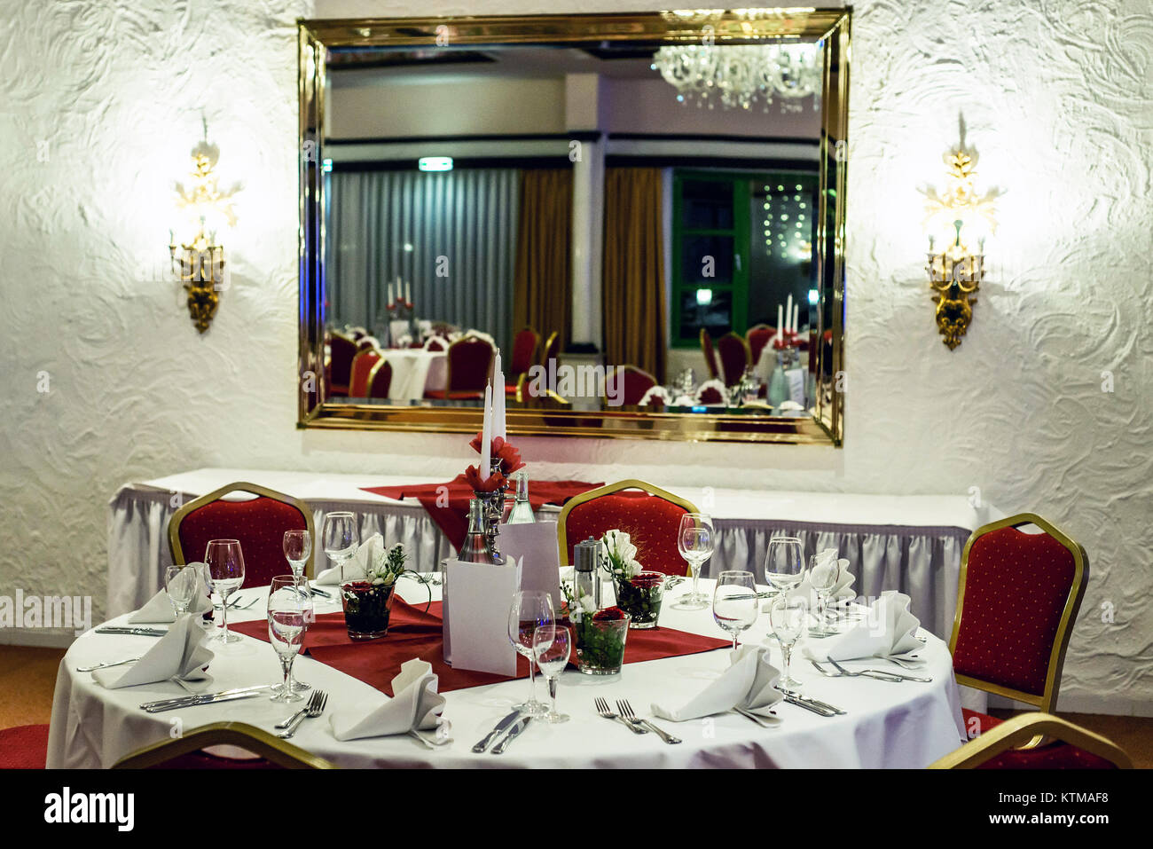 Banquet With Red Table Setting Red Tablecloth White Dishes