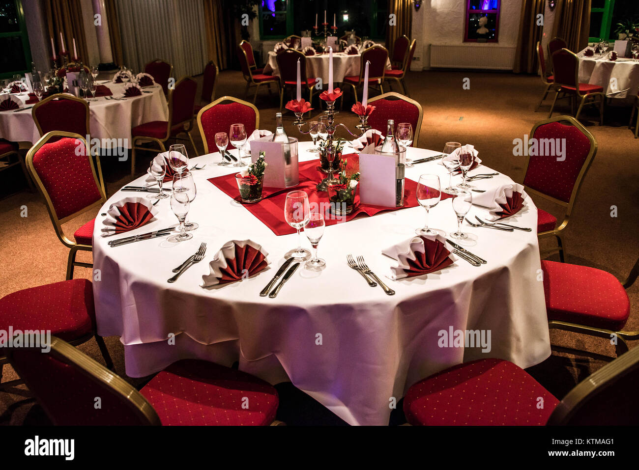Banquet with red table setting Red tablecloth white dishes silver cutlery and glasses plus some decorations white copy text space card & Banquet with red table setting Red tablecloth white dishes silver ...