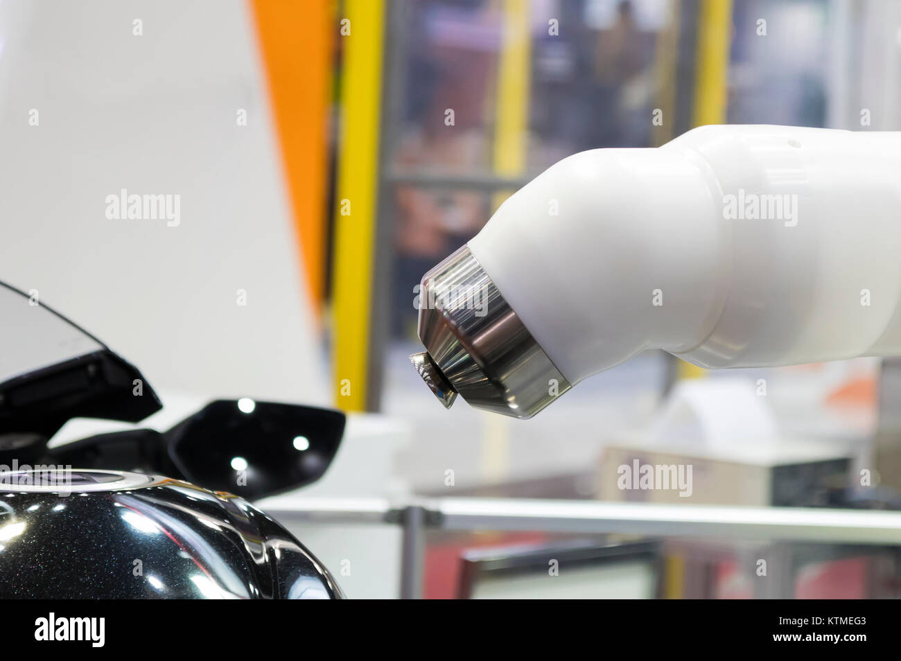 Spray painting robot and body part ; close up - Stock Image