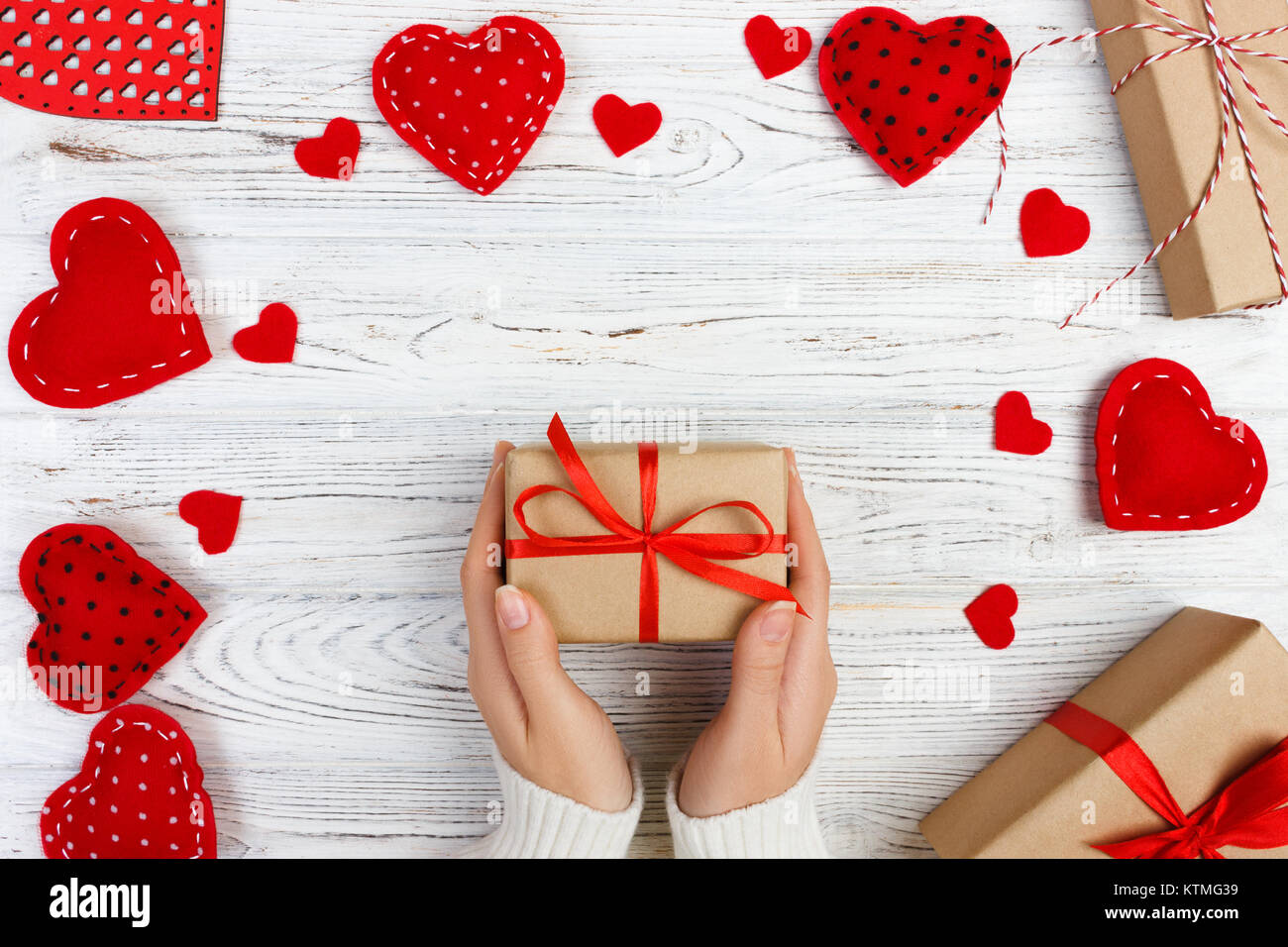 Girl Hand Give Valentine Gift Box With A Red Heart Inside On A White