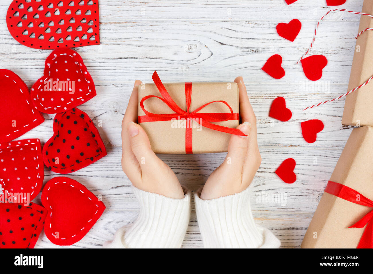 Valentines Day background. girl hand give valentine gift box with a red heart inside on a white old wooden table. Valentine day.  sc 1 st  Alamy & Valentines Day background. girl hand give valentine gift box with a ...