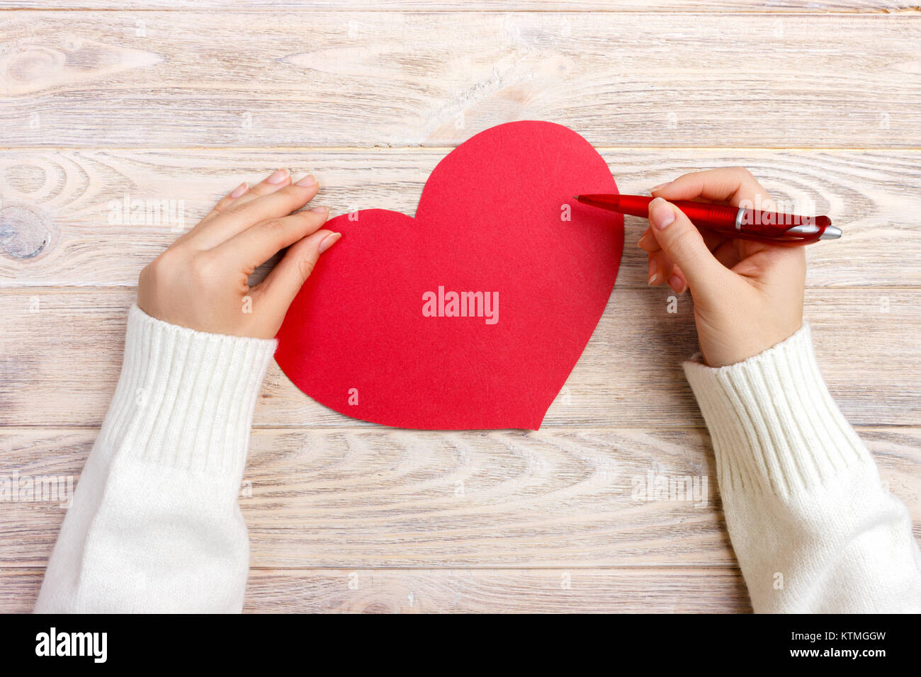 Hand of girl writing love letter on valentine day handmade red hand of girl writing love letter on valentine day handmade red heart postcard woman write on postcard for 14 february holiday celebration flat lay spiritdancerdesigns Gallery