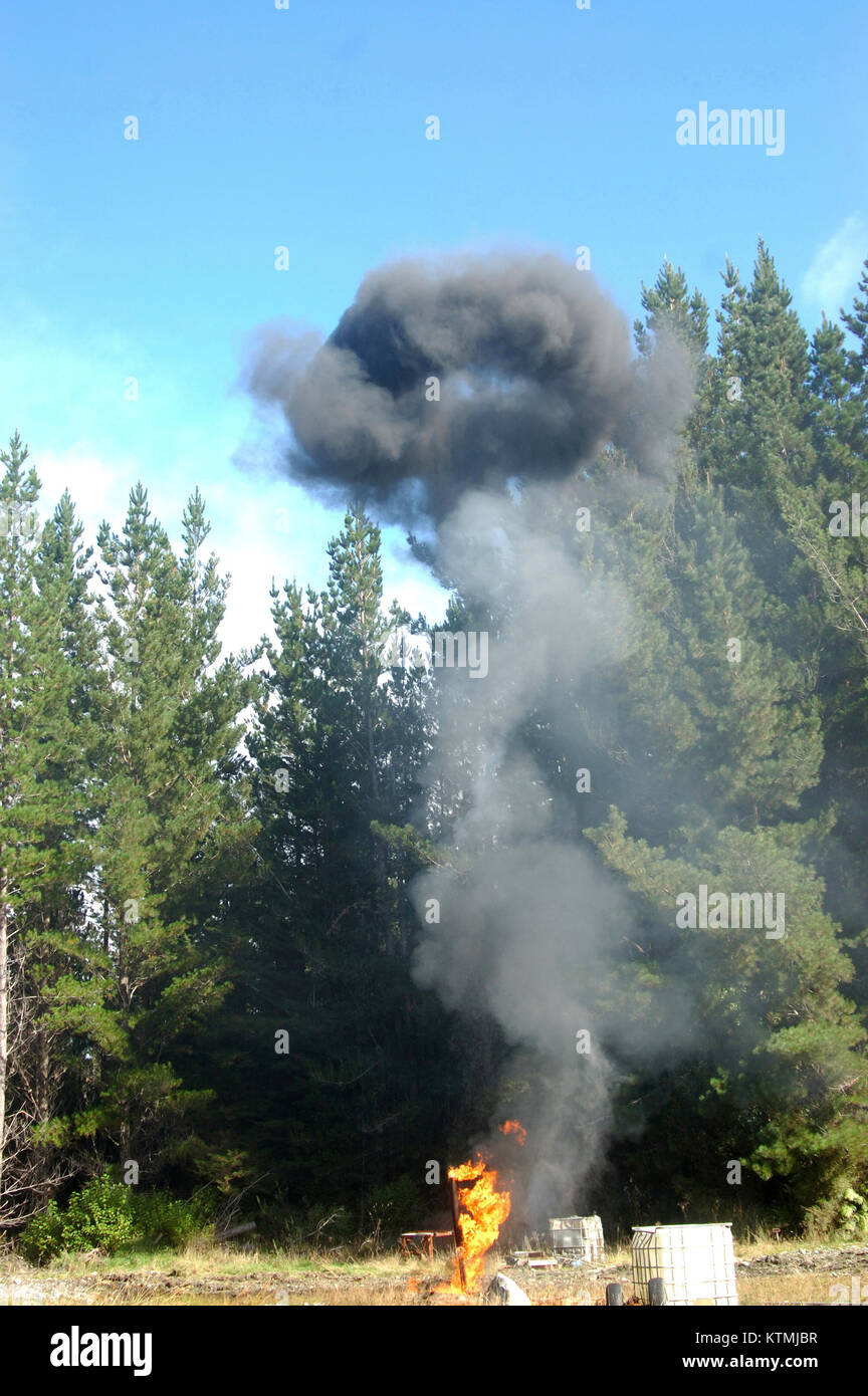 Smoke ring from flare burning off gas and oil at Niagara 1 oil well, West Coast, South Island, New Zealand - Stock Image