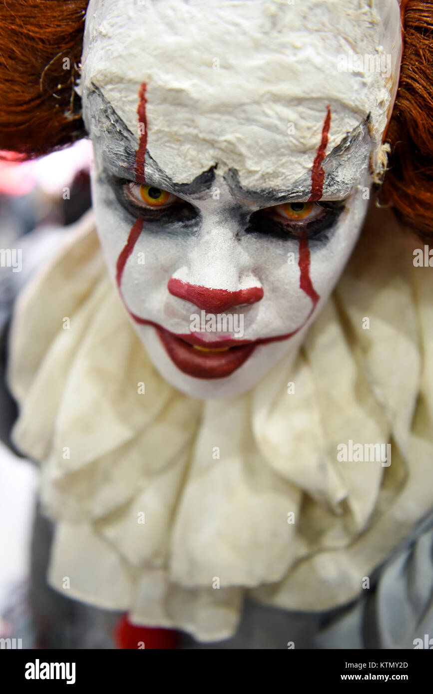 Close-up portrait of the cosplayer posing as 'Pennywise the Clown' character at the Comic Con in London, - Stock Image