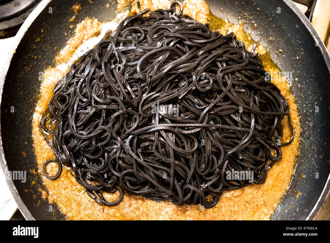 black pasta squid ink pan up view italian taglierini al nero di seppia - Stock Image