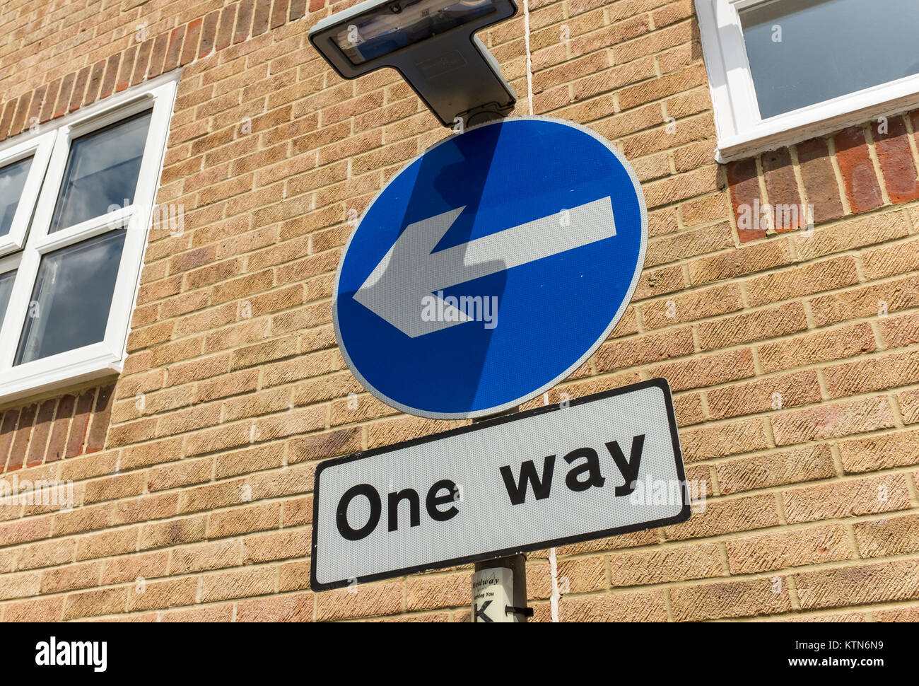 One Way Highway Code sign (blue circle with white arrow) for road users, UK - Stock Image