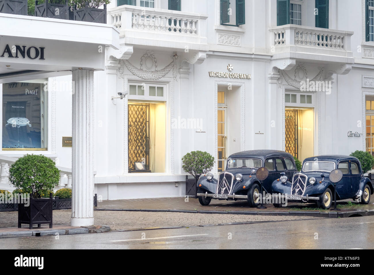 Metropole Hotel in Hanoi on a rainy day in February. This legendary  hotel built in French colonial style the hotel - Stock Image