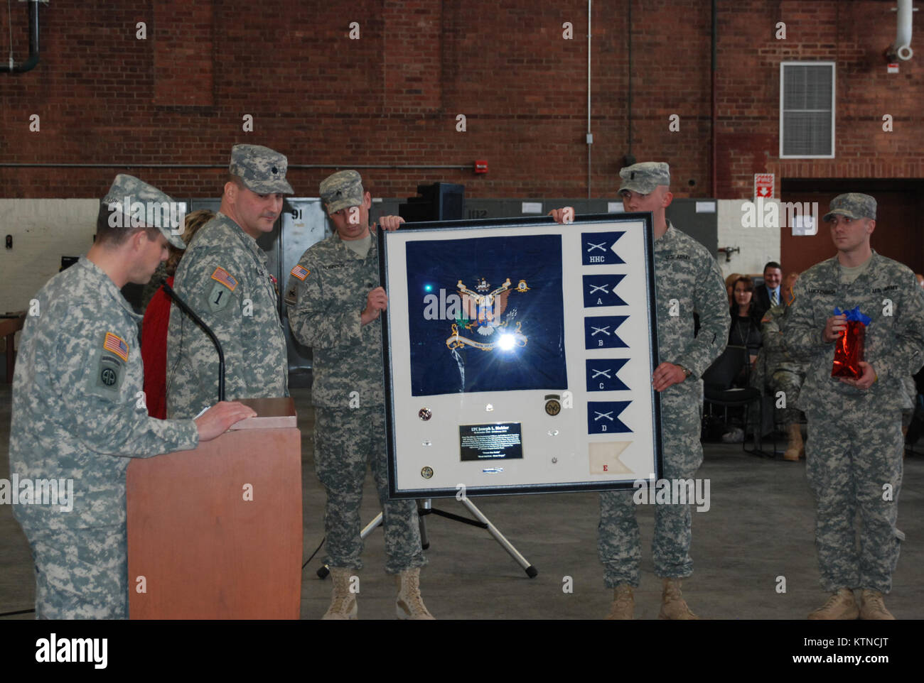 UTICA, N.Y. – Soldiers of the New York Army National Guard's 2nd Battalion, 108th Infantry present a unit gift representing Stock Photo