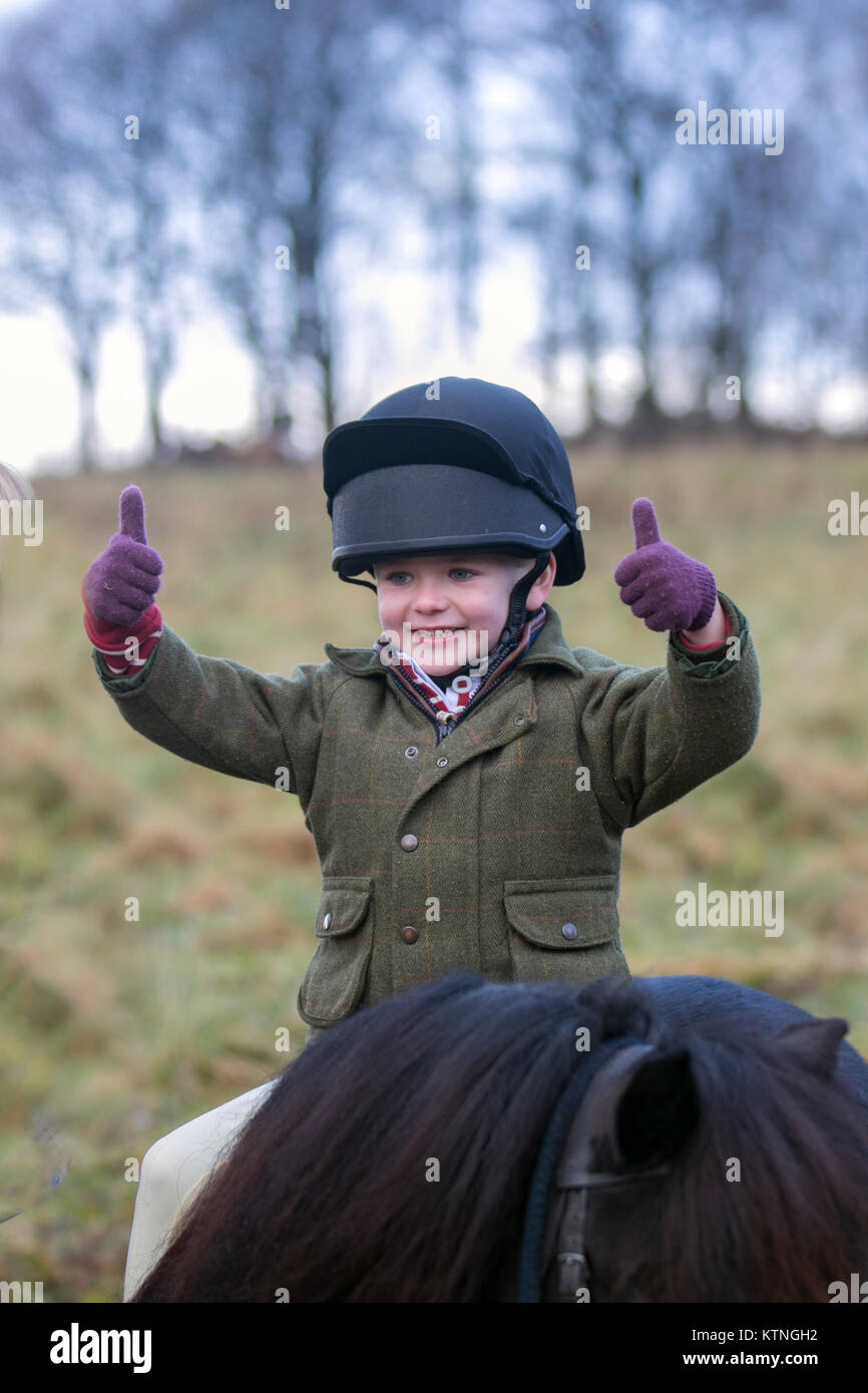 Rivington, Lancashire, UK. 26th December, 2017. Freddie riding Ozzie at Holcombe Hunt's traditional Boxing Day meet - Stock Image