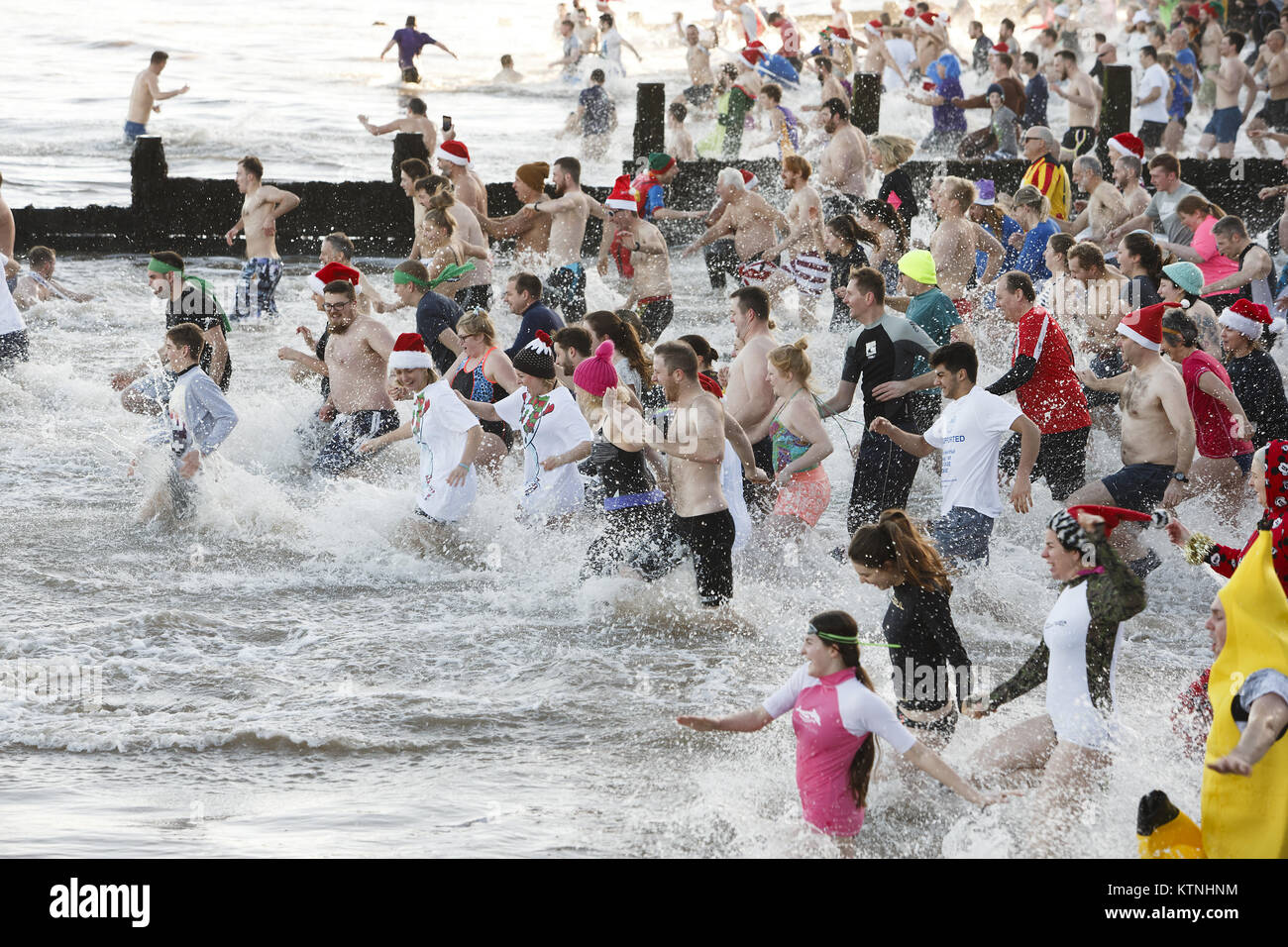 Boxing Day swimmers race to take the plunge at Cromer, Norfolk, in aid of the Stroke Associaition. Credit: Keith - Stock Image