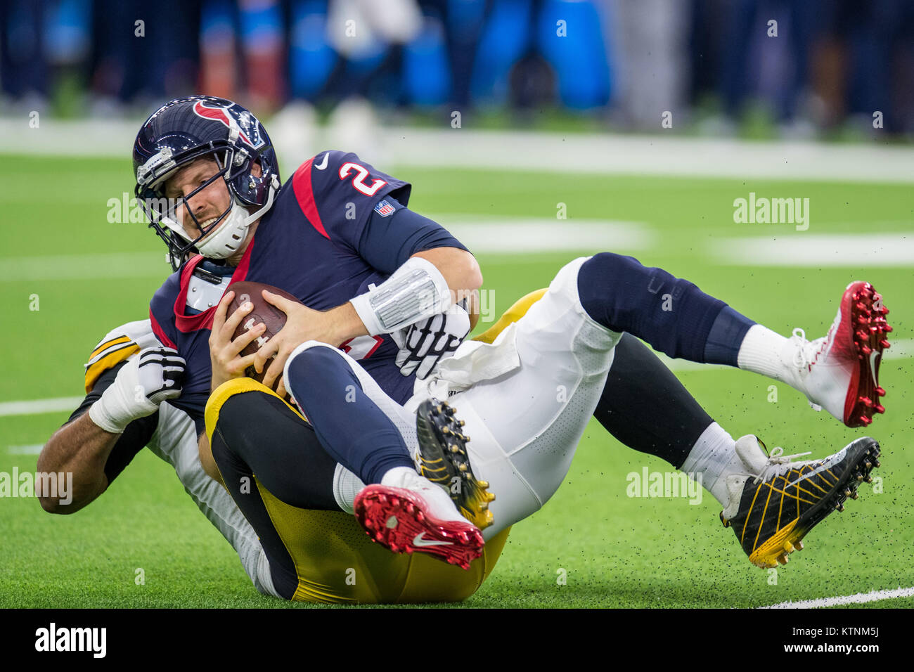 Houston, TX, USA. 25th Dec, 2017. Houston Texans quarterback T.J. Yates (2) is sacked by Pittsburgh Steelers defensive - Stock Image