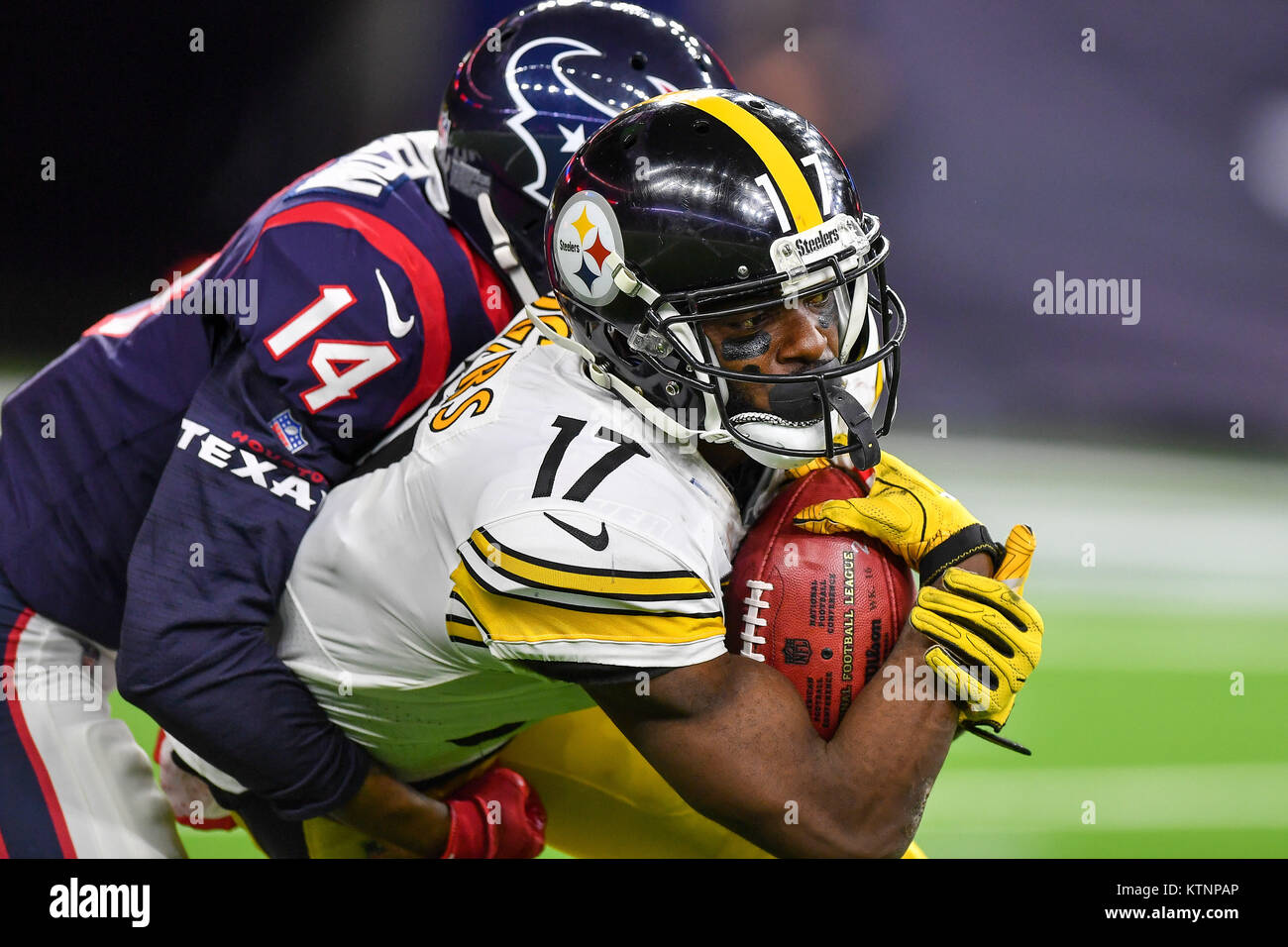ac8857d22 ... Pittsburgh Steelers wide receiver Eli Rogers (17) is tackled by Houston  Texans wide receiver ...