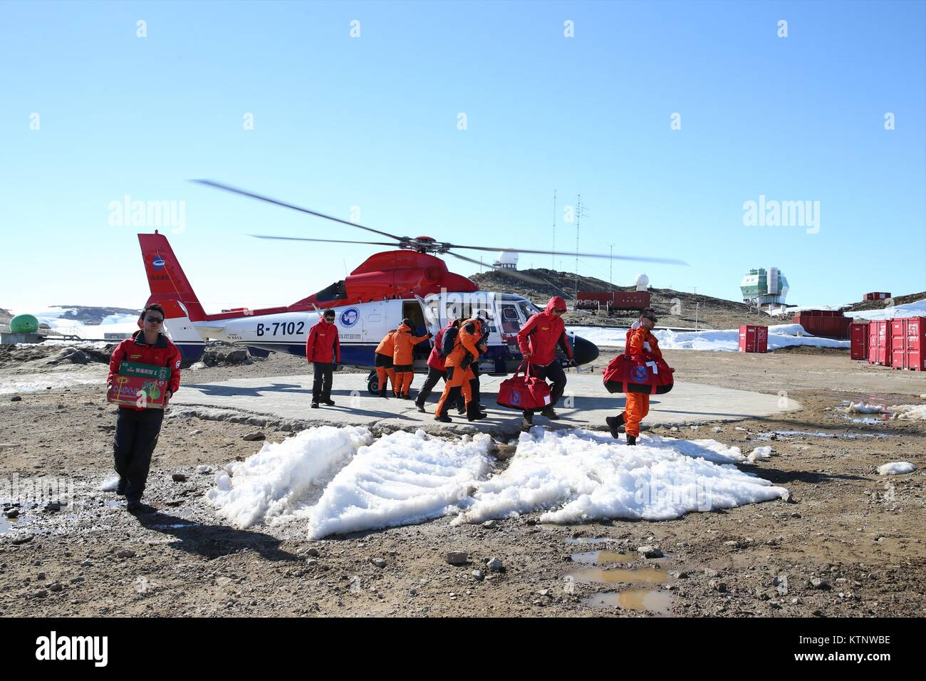 dd01eb76f7a Members of China's Antarctic expedition get off a helicopter after arriving  at Zhongshan station in Antarctic, Dec. 27, 2017. China's research  icebreaker ...