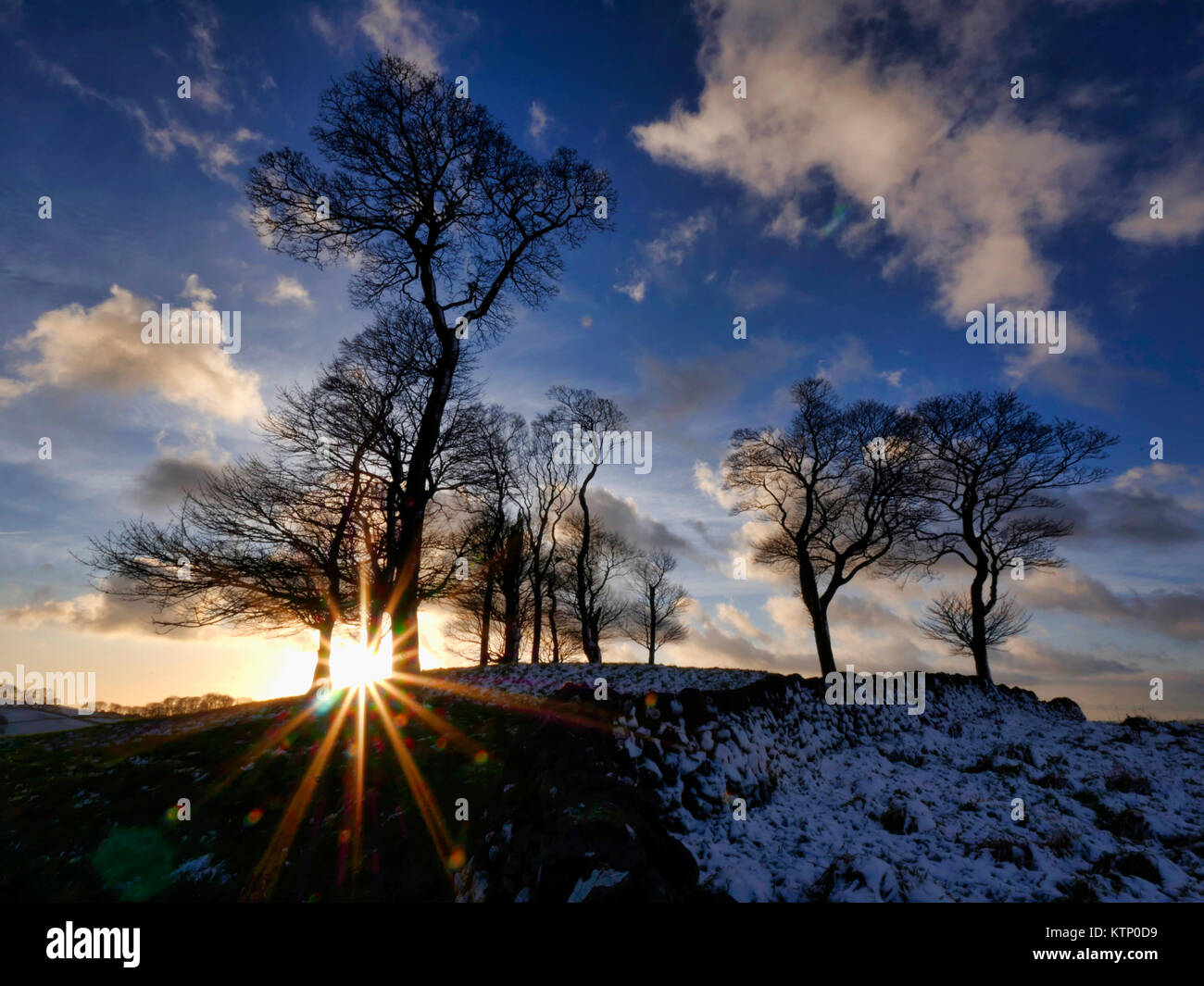 Moat Low, Derbyshire. 28th Dec, 2017. UK Weather: Moat Low Derbyshire spectacular sunset over the snow capped Bronze Stock Photo