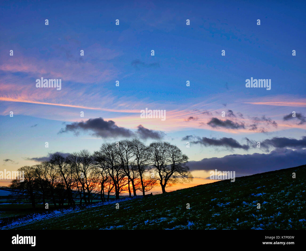 Moat Low, Derbyshire. 28th Dec, 2017. UK Weather: Near Moat Low Derbyshire spectacular sunset over the snow cappedStock Photo