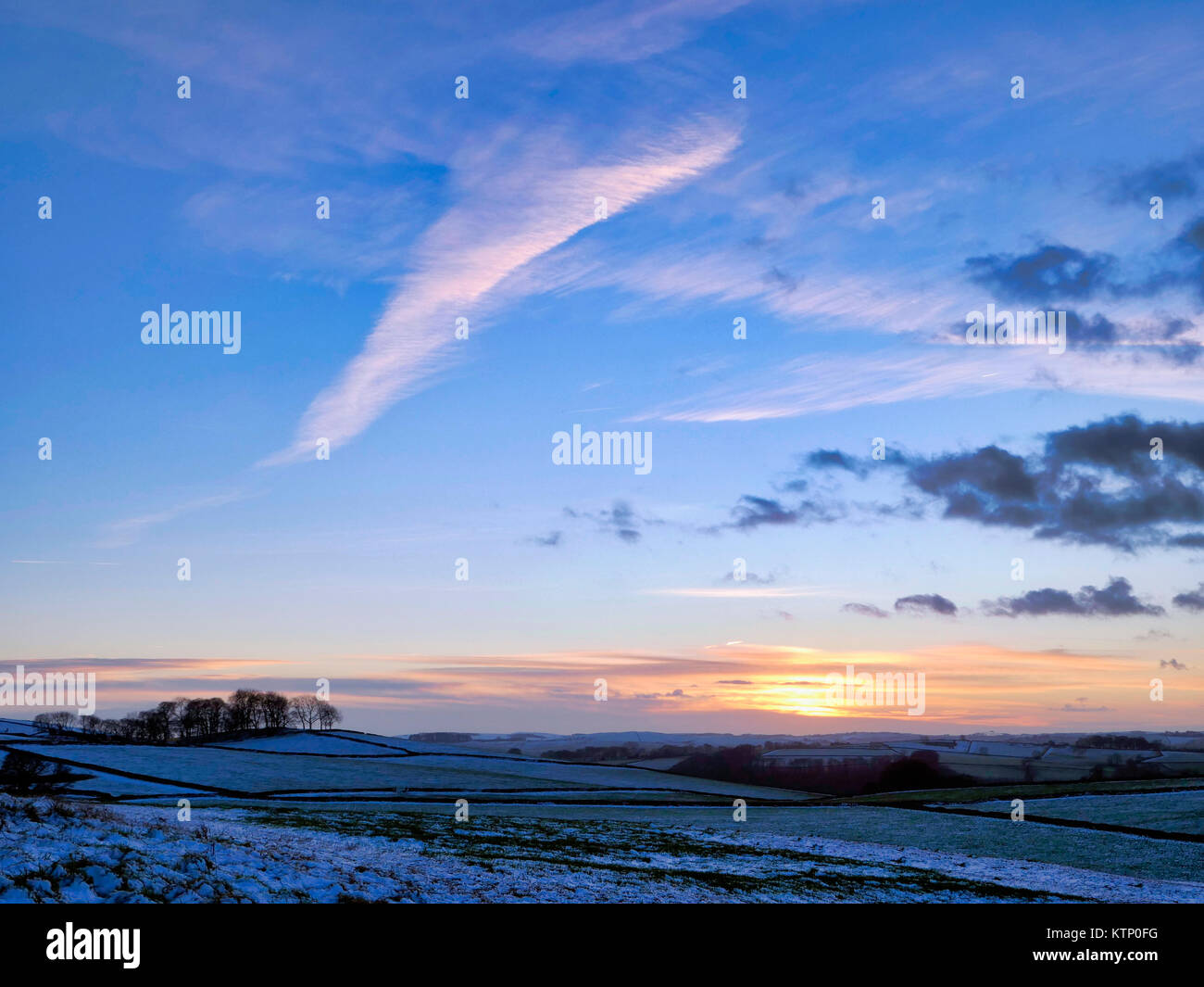 Moat Low, Derbyshire. 28th Dec, 2017. UK Weather: View from Moat Low Derbyshire spectacular sunset over the snowStock Photo