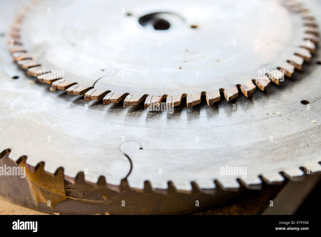 Close up image of metal circular saw attachment for woodworking - Stock Image