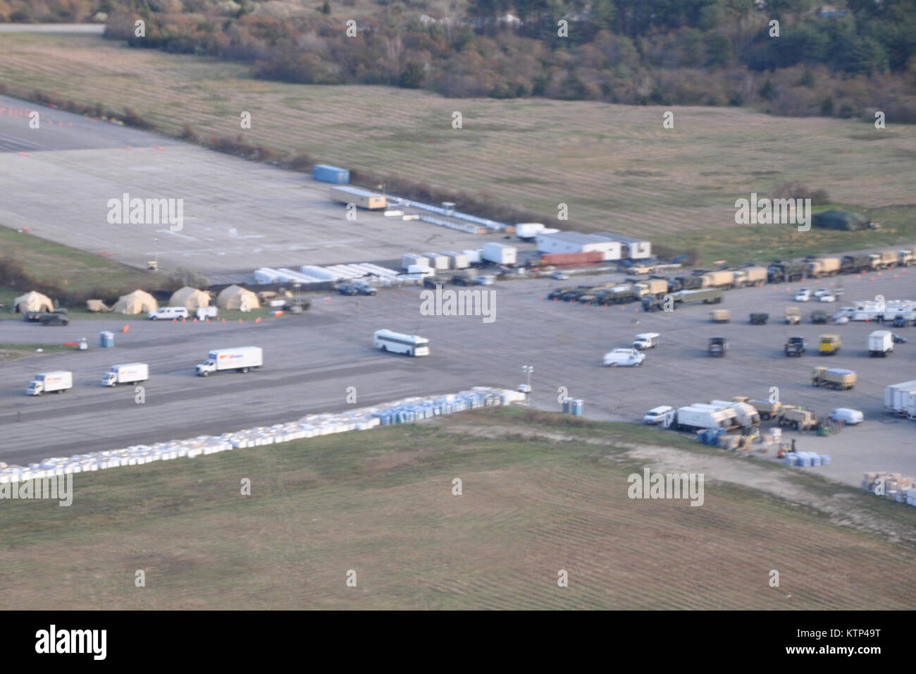 New York Army National Guard sets up a logistics support area at Floyf Bennett Field in Queens, NY to consolidate - Stock Image