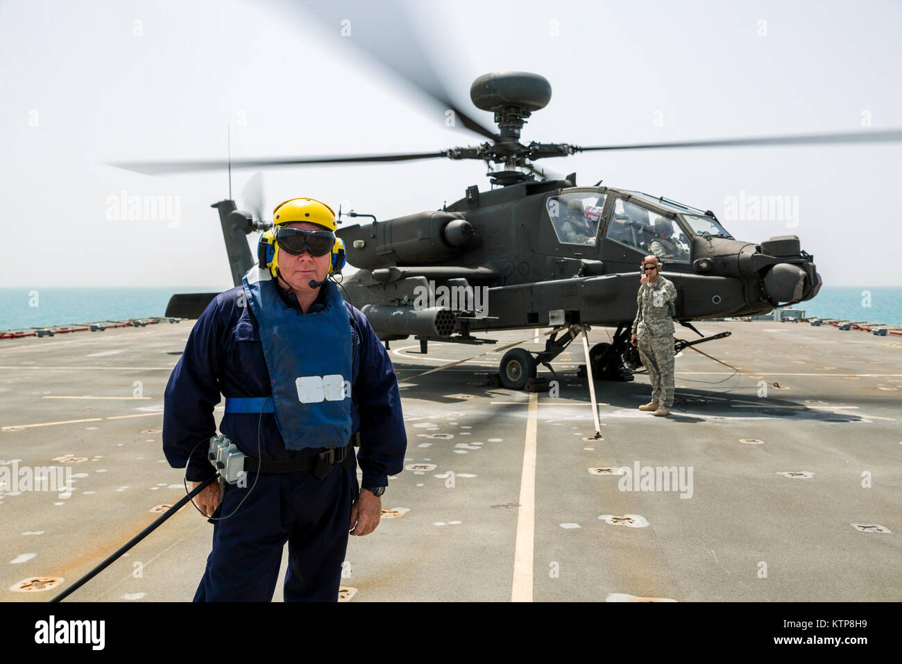 Petty Officer Ian Walker, a deck hand on the RFA Cardigan Bay, Royal Fleet Auxiliary, U.K. Royal Navy, stands in Stock Photo