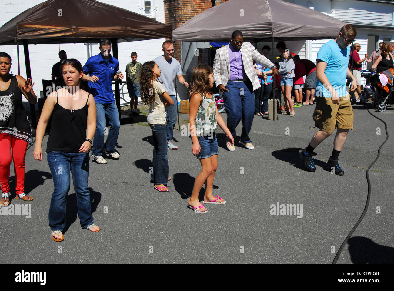 POESTENKILL – Soldiers and their family members of the 42nd Infantry Division enjoyed a sunny afternoon dancing - Stock Image