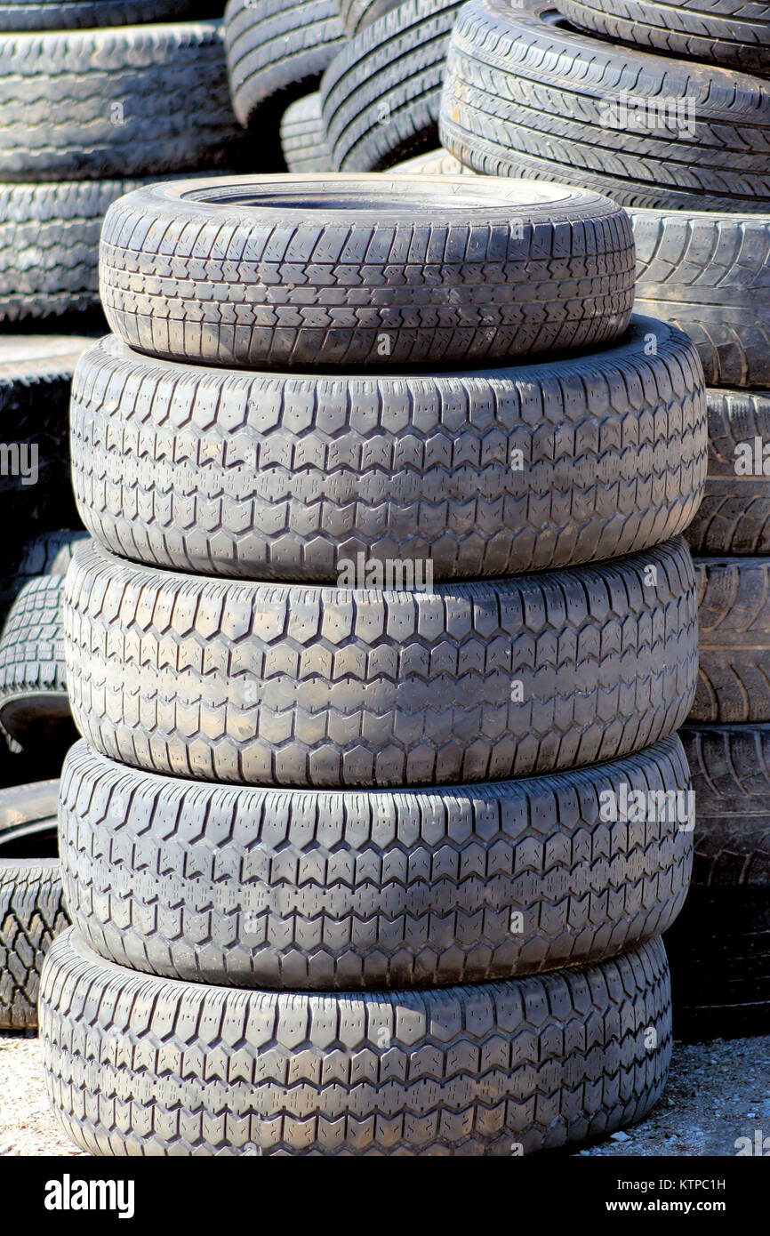 Old used tires at recycling centre/landfill - Stock Image