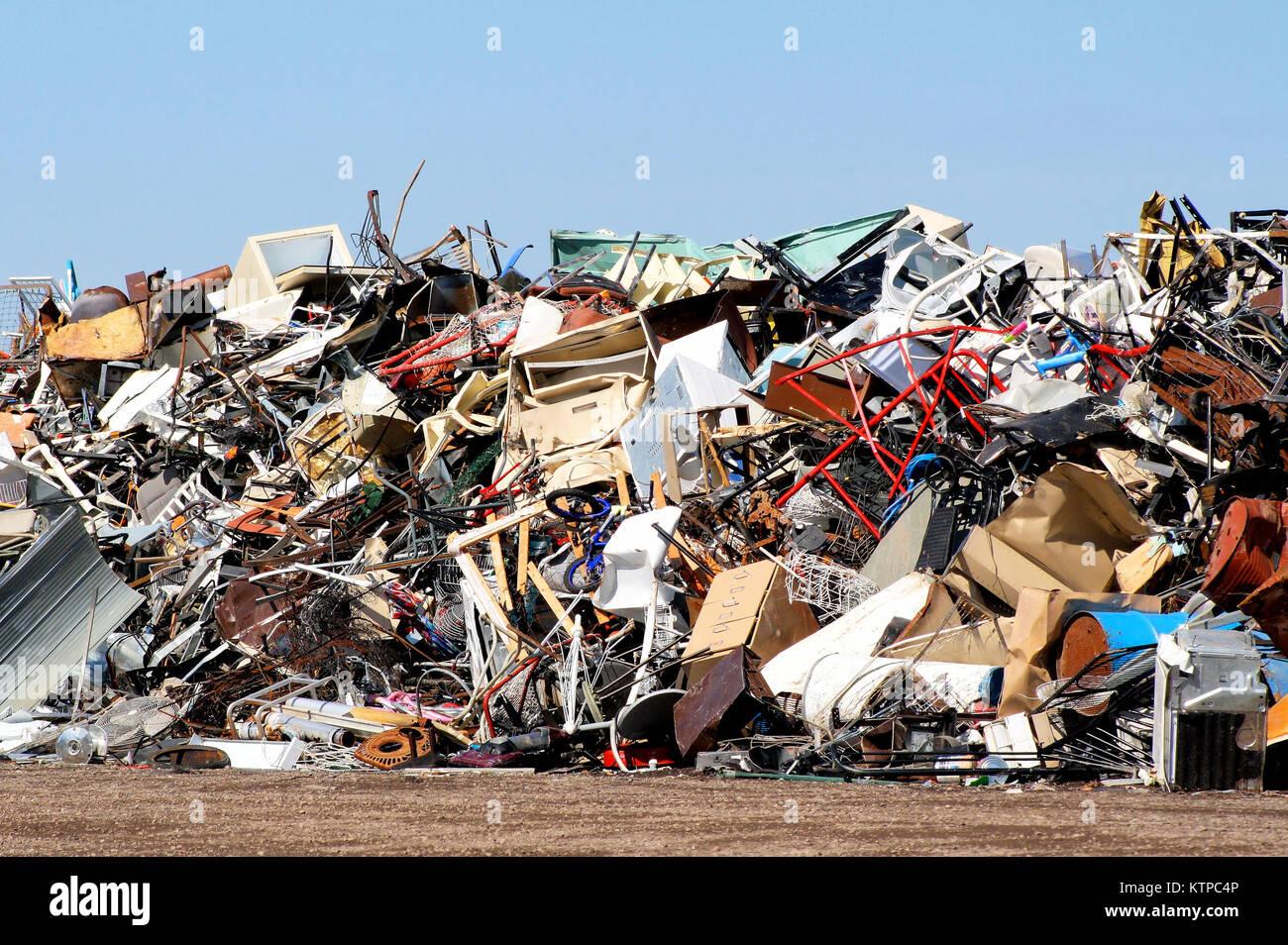 Garbage piled high at an outdoor landfill - scrap yard - Stock Image