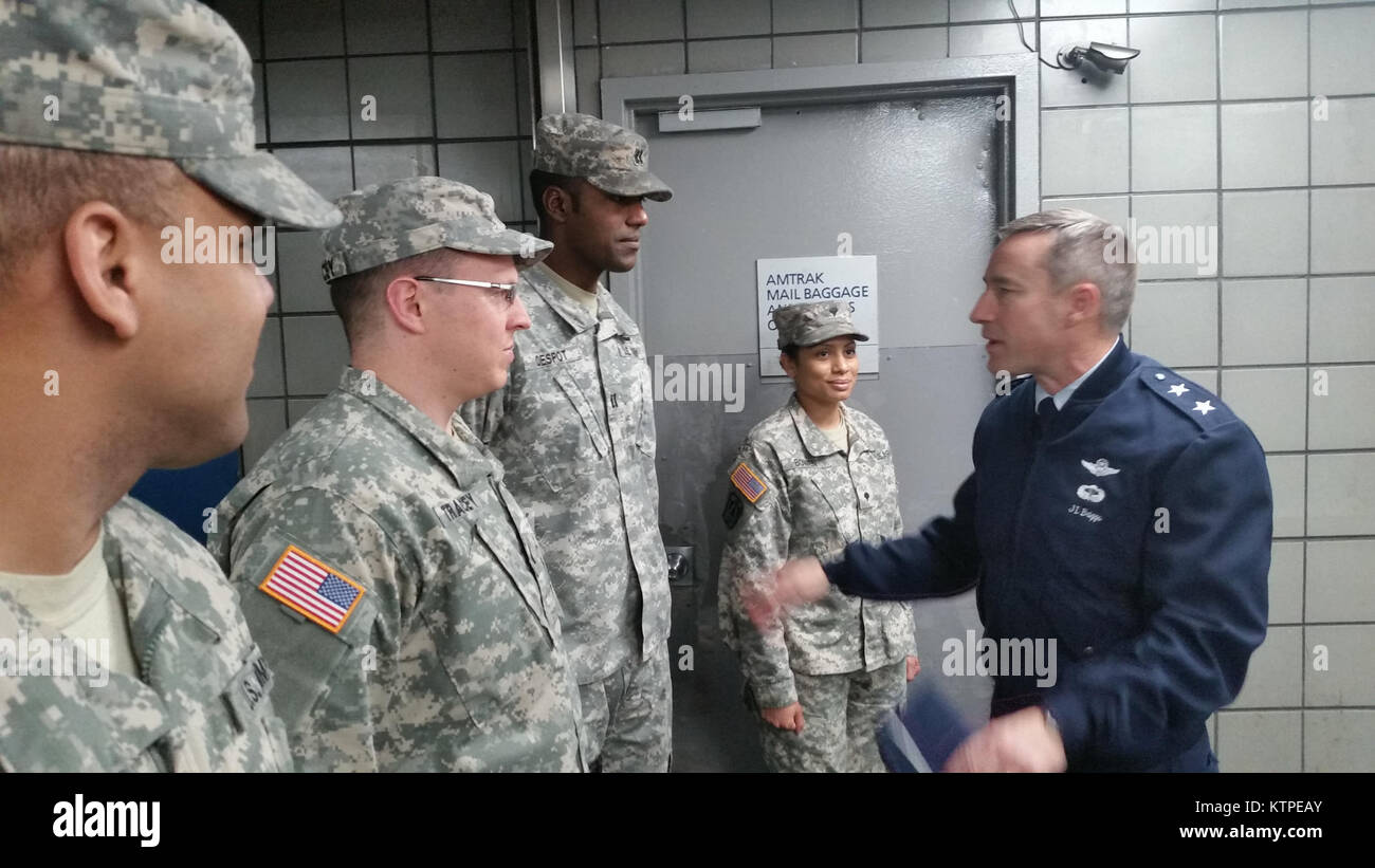 Maj. Gen. Jack Briggs, right, Director of Operations for Headquarters U.S Northern Command, visits with (from left) New York Army National Guard Staff Sgt. Jose Batista of Company A, 101st Expeditionary Signal Battalion, 1st Lt. Mike Tracy of Company G, 427 Brigade Support Battalion, Capt. Odelle Despot, commander of the 719th Transportation Company and Spc. Catarina Bowen of Company B, 101st Signal Battalion.  The Soldiers are part of Joint Task Force Empire Shield, a security enhancement force performing state active duty in New York City to augment law enforcement. Some 500 Soldiers and Air Stock Photo