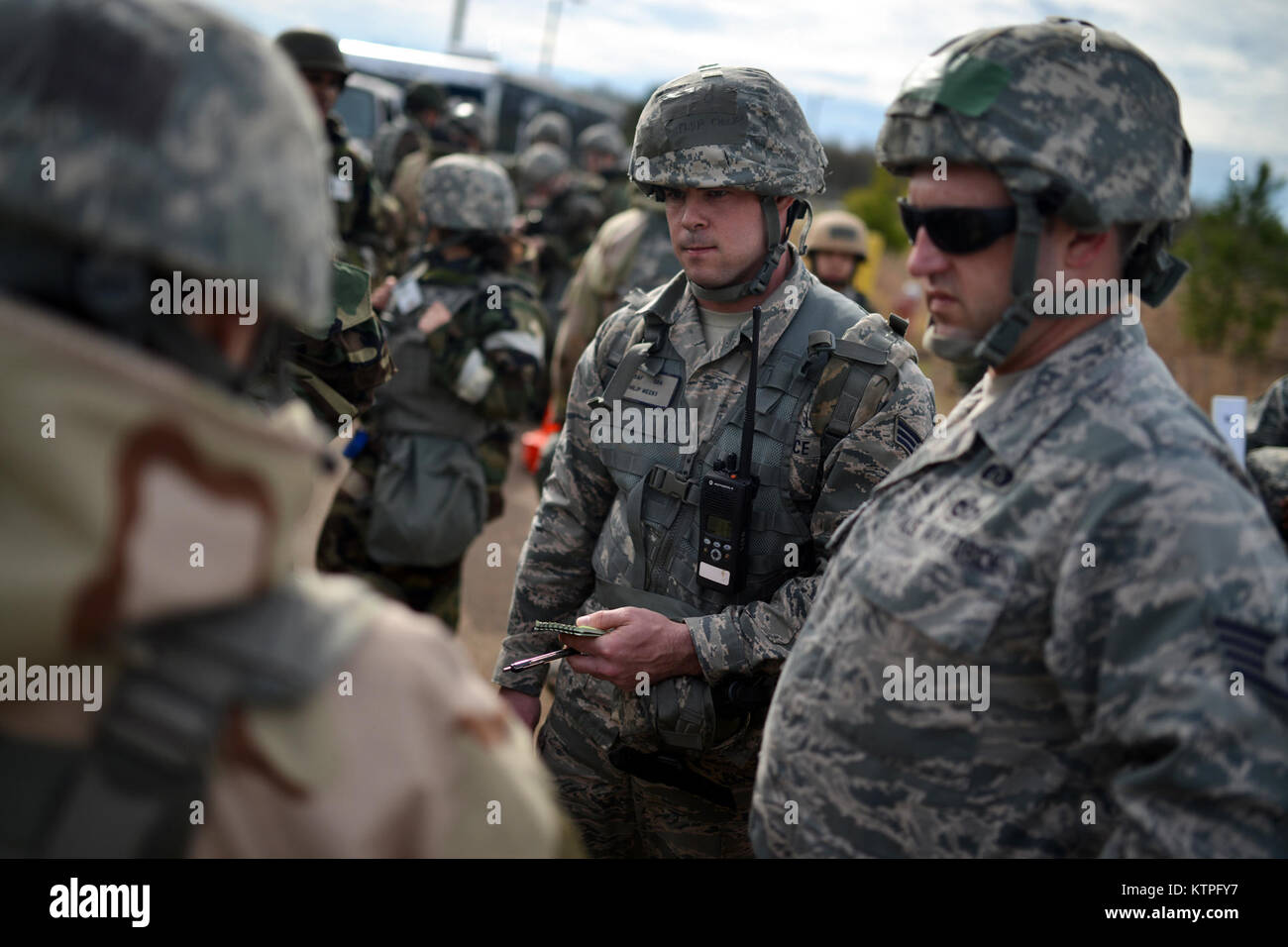 PERRY, GA - Senior Airman Phillip Meeks, an Air National Guard Emergency Manager, listens during a mission brief Stock Photo