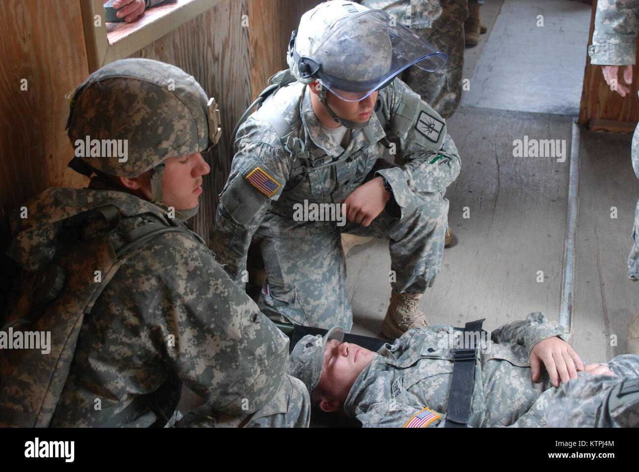 Soldiers from the 102nd Military Police Battalion, Headquarters Detachment from Auburn, conduct detainee operations Stock Photo