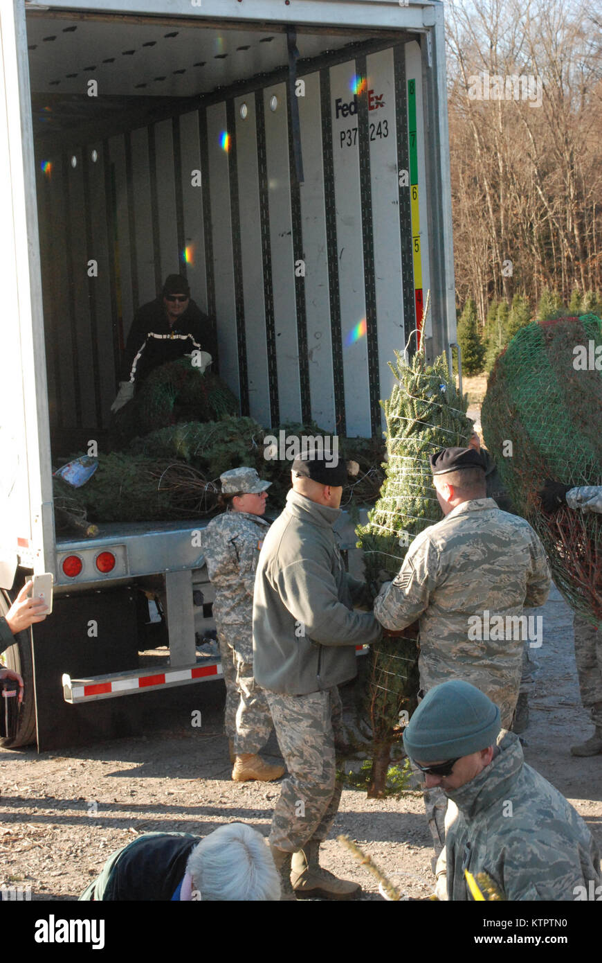 Twenty members of the New York Army and Air National Guard volunteered their time to help load about 125 donated Stock Photo