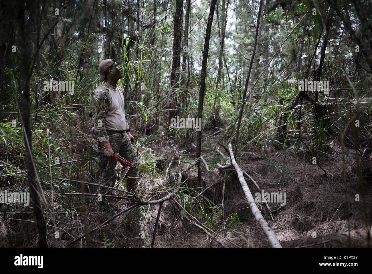 HOMESTEAD AIR RESERVE BASE, FLORIDA - Senior Airman Ian Kuhn, a SERE (Survival, Evasion, Resistance, and Escape) Stock Photo