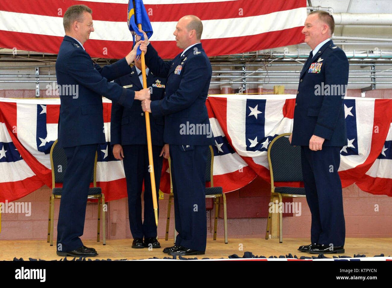 Maj. Gen. Anthony German, New York National Guard Adjutant General, hands the 106th Rescue Wing guidon to Col. Michael Stock Photo