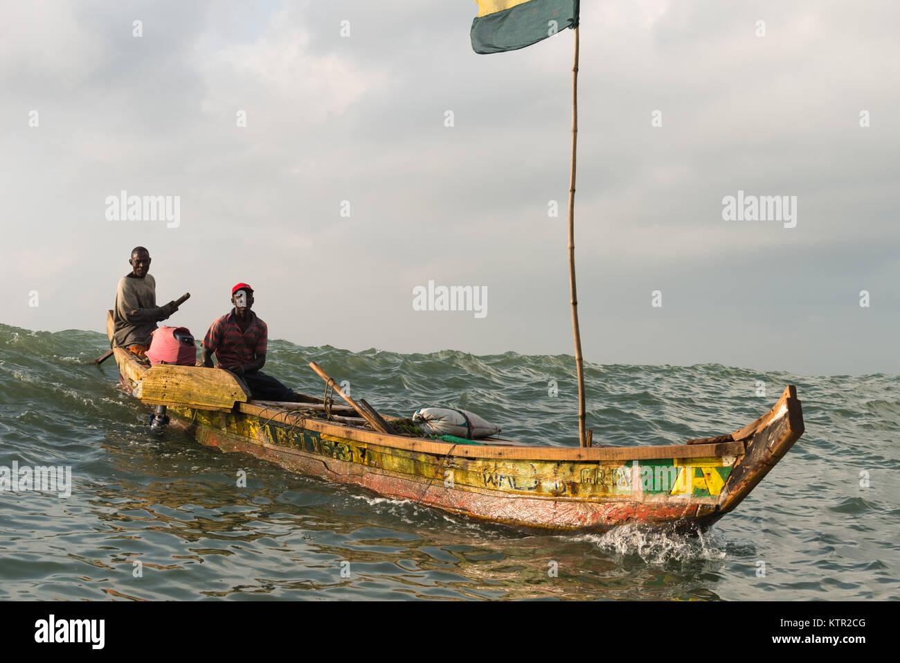 Net-fishing in an open boat along the Golden Coast, Central Region, Ghana, Africa - Stock Image