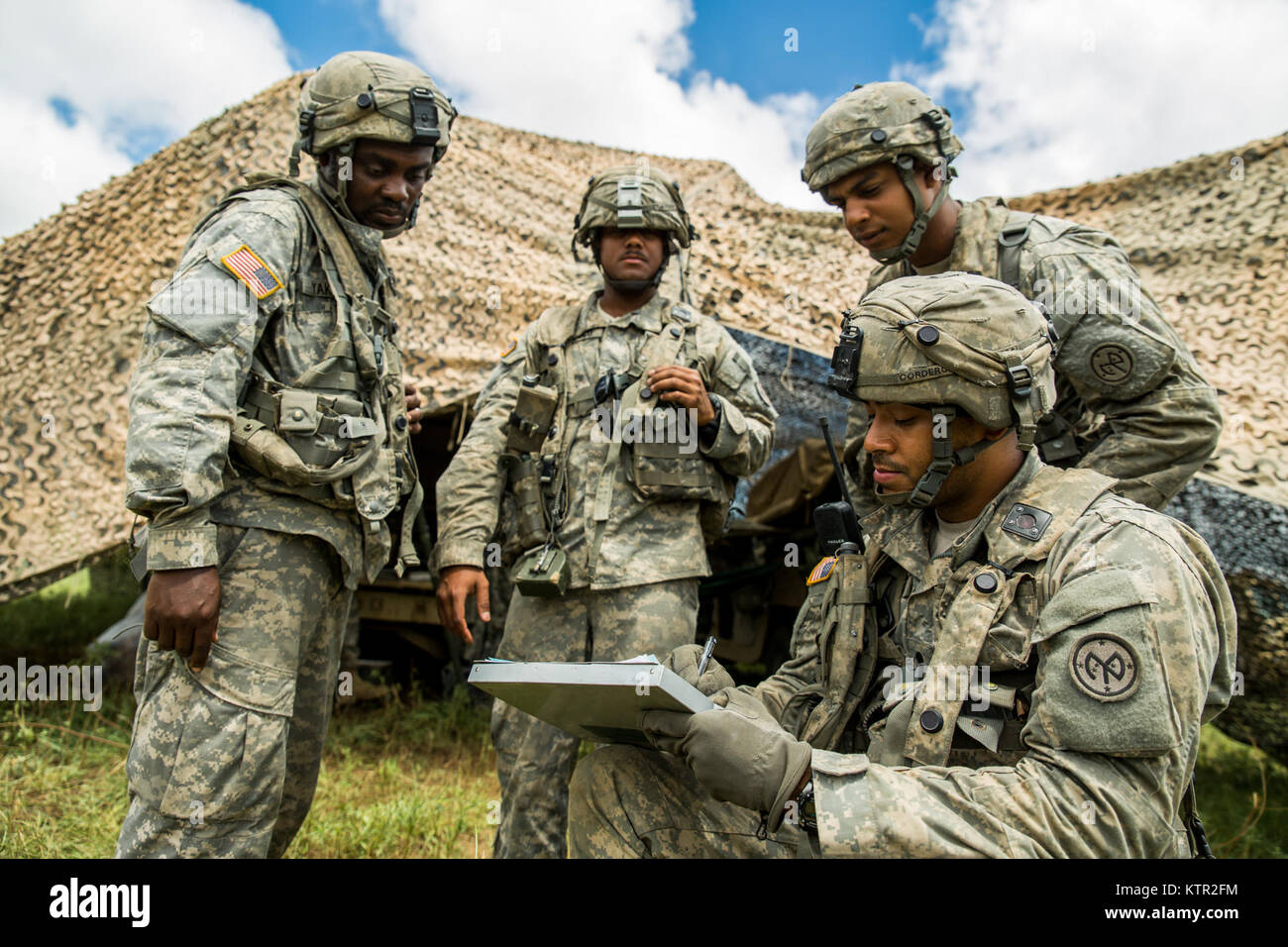 U.S. Army Spc. Jose Cordero, a radiotelephone operator with Battery B, 1st Battalion, 258th Field Artillery Regiment, Stock Photo
