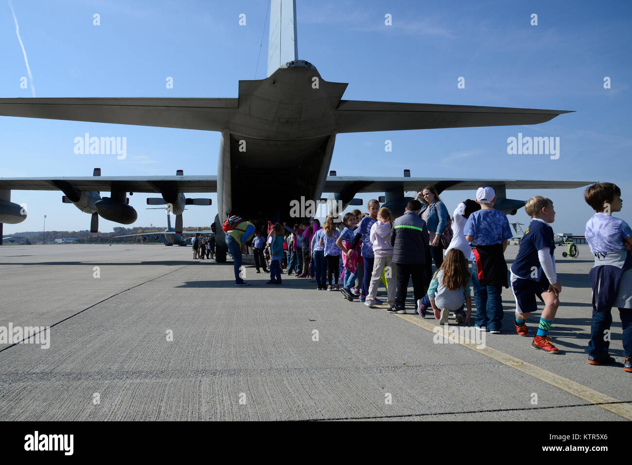 Delaware Valley School District students, teachers and parents tour a Marine KC-130T Hercules during a tour of Stewart - Stock Image