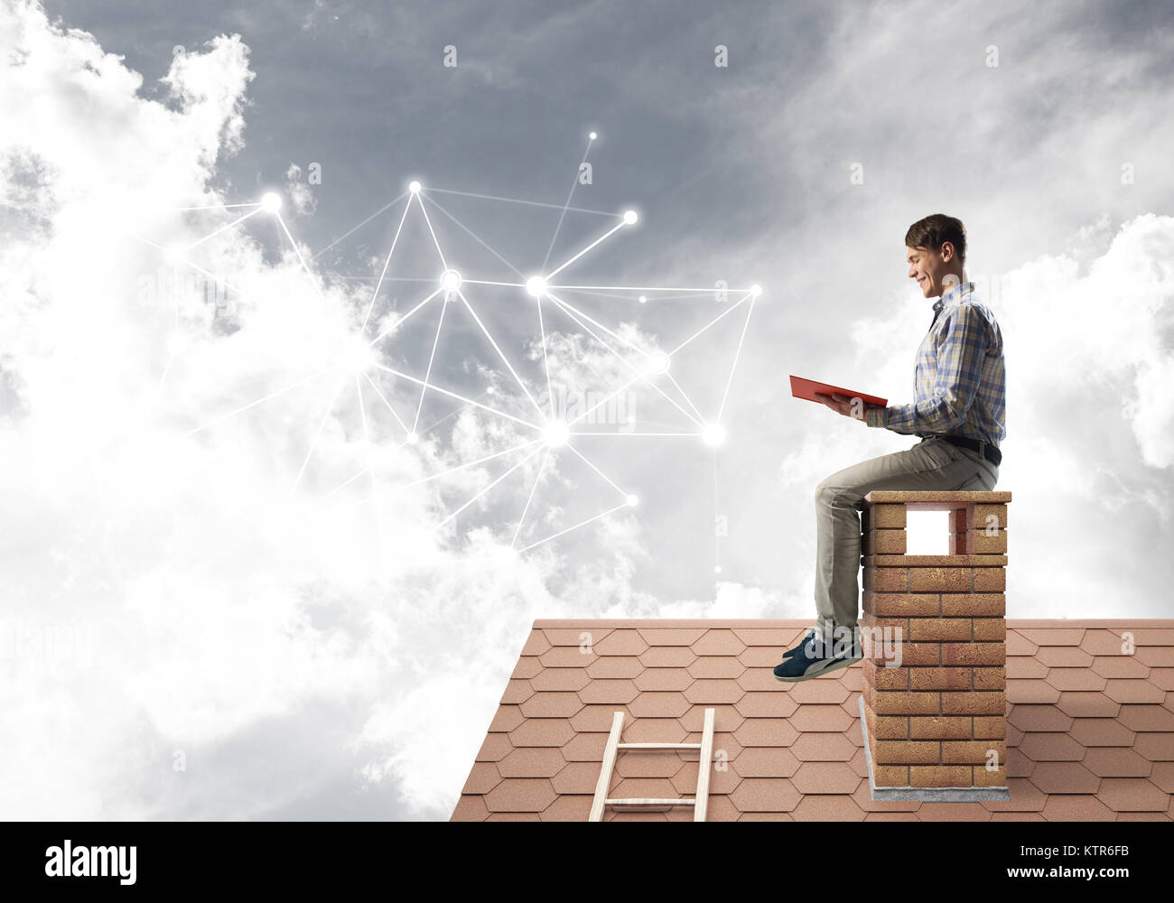 Man on brick roof reading book and concept of social connection - Stock Image