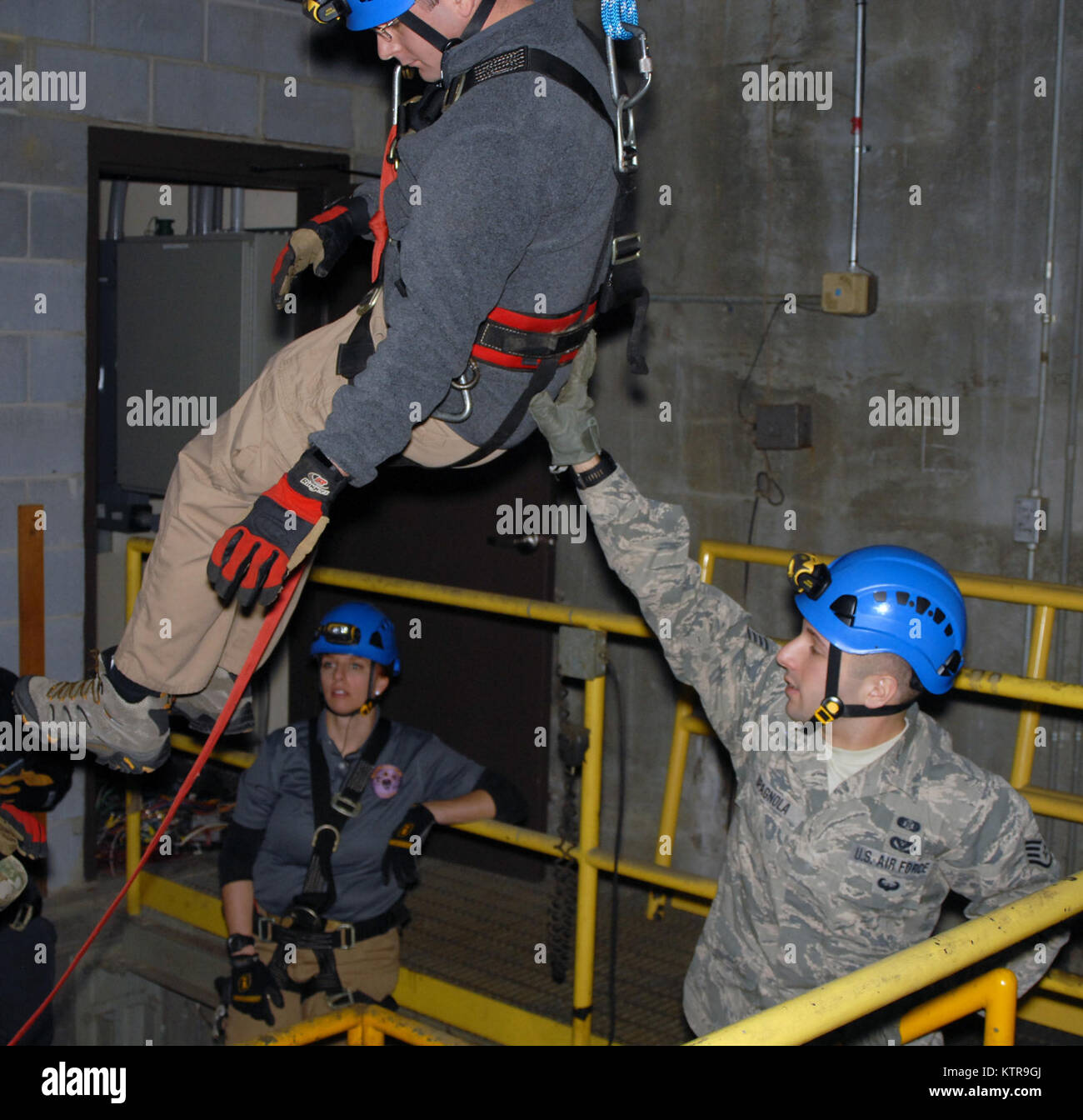 Staff Sgt. Joshua Spagnola of the New York National Guard's 2nd Civil Support Team (right) guides New York State - Stock Image