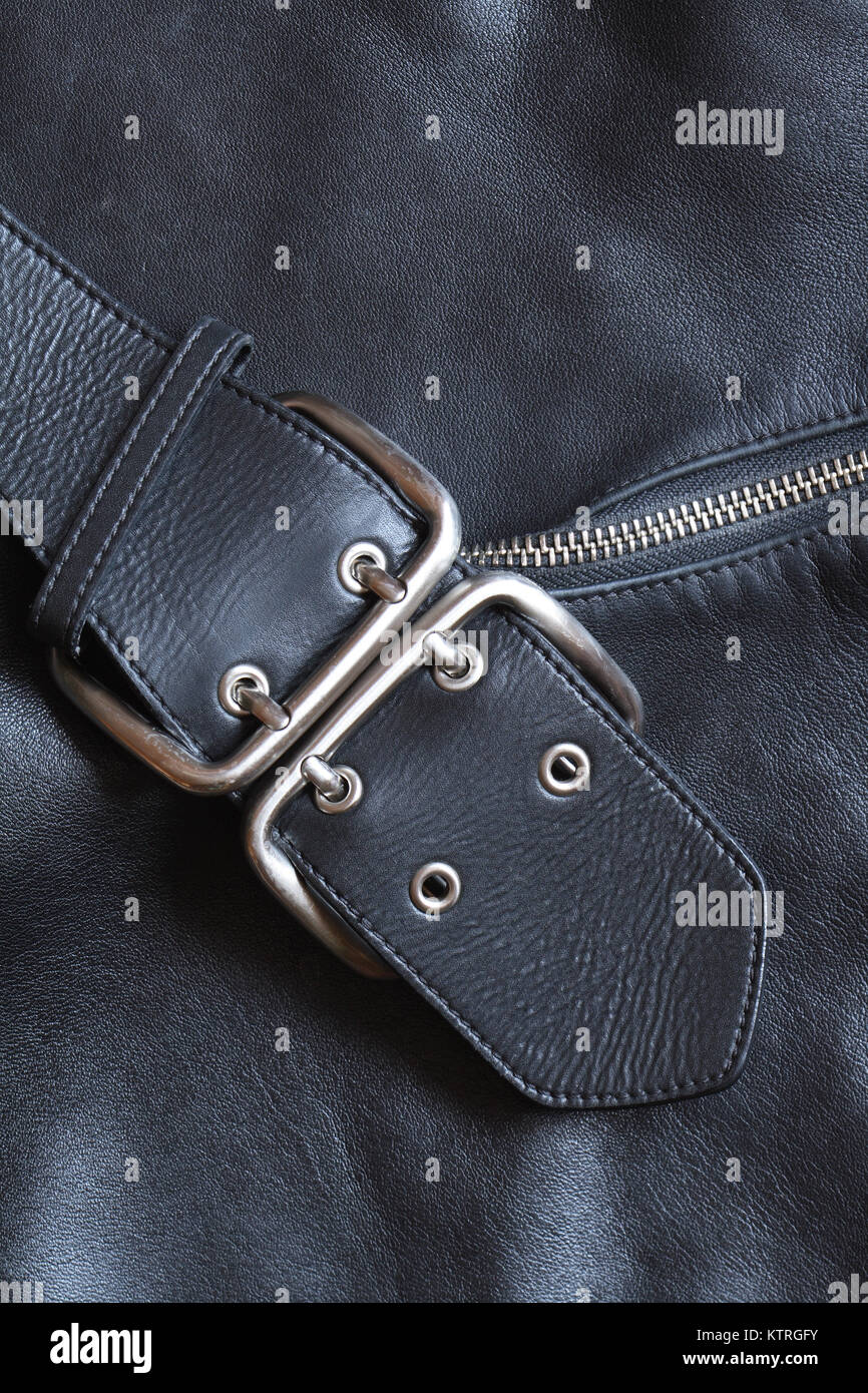 Closeup black leather background with belt and zipper - Stock Image